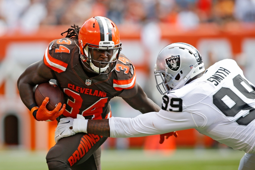 Sep 27, 2015; Cleveland, OH, USA;  Cleveland Browns running back Isaiah Crowell (34) evades a tackle by Oakland Raiders defensive end Aldon Smith (99) during the second quarter at FirstEnergy Stadium. The Raiders defeated the Browns 27-20. Mandatory Credit: Scott R. Galvin-USA TODAY Sports