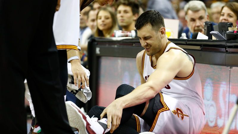 Andrew Bogut holds his leg in pain just seconds after he fractures it