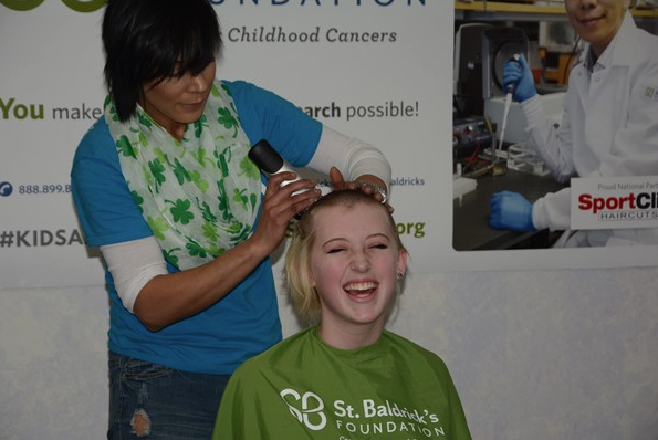 LHS Student Ella Chanter gets her head shaved at the St. Baldrick's event.