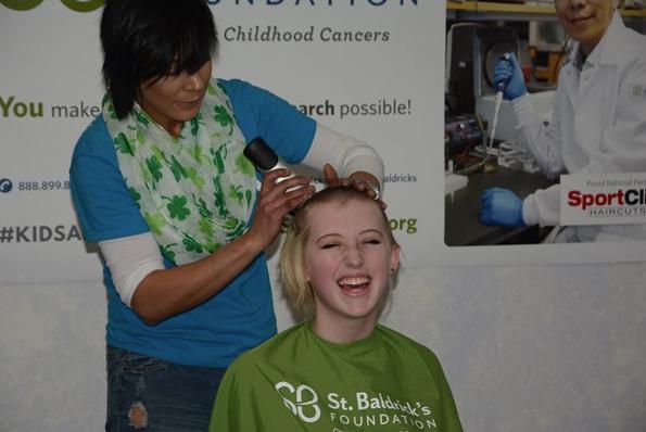 LHS Student Ella Chanter gets her head shaved at the St. Baldricks event.