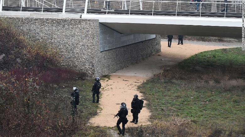 Members of the French police special forces RAID conduct searches on a bank of the river Rhine in Strasbourg, on December 12, 2018, in order to find the gunman who opened fire near a Christmas market the night before, in Strasbourg, eastern France. - Hundreds of security forces were deployed in the hunt for a lone gunman who killed at least two people and wounded a dozen others at the famed Christmas market in Strasbourg, with the French government raising the security alert level and reinforcing border controls. (Photo by Frederick FLORIN / AFP)        (Photo credit should read FREDERICK FLORIN/AFP/Getty Images)