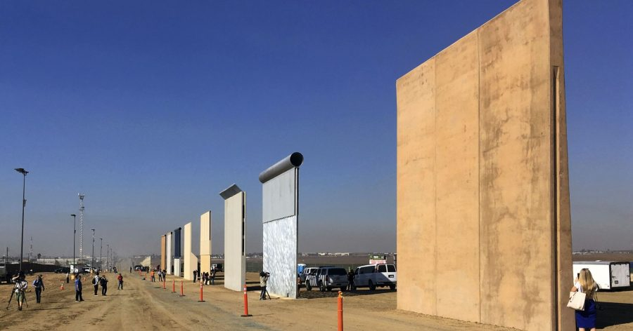 Photo shows different prototypes for the wall in San Diego