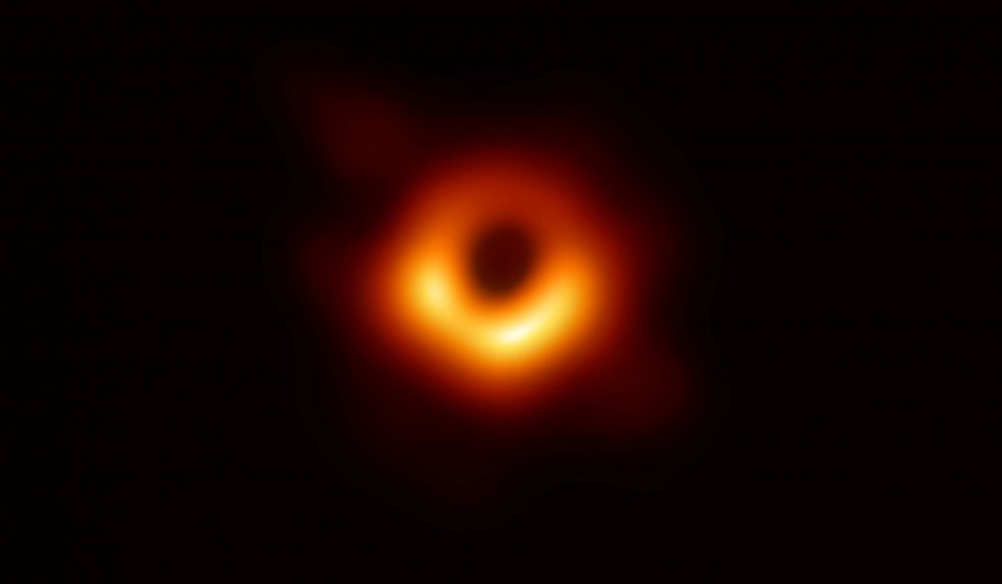 REFILE - CORRECTING SPELLING The first ever photo of a black hole, taken using a global network of telescopes, conducted by the Event Horizon Telescope (EHT) project, to gain insight into celestial objects with gravitational fields so strong that no matter or light can escape, is shown in this handout released April 10, 2019.  Event Horizon Telescope (EHT)/National Science Foundation/Handout via REUTERS   ATTENTION EDITORS - THIS IMAGE WAS PROVIDED BY A THIRD PARTY.  NO RESALES. NO ARCHIVE.