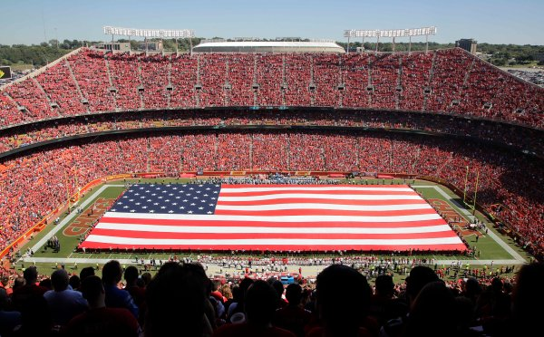 A giant flag is spread over the field at Arrowhead Stadium to commemorate Sept. 11, before an NFL football game between the Kansas City Chiefs and the San Diego Chargers in Kansas City, Mo., Sunday, Sept. 11, 2016. (AP Photo/Charlie Riedel)